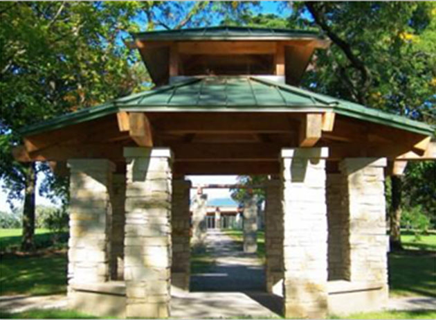 John Larkins Bell Gazebo is a small open-walled gazebo with a roof made of wood and metal and stone supports