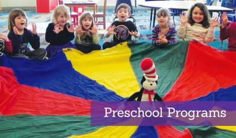 Preschool children playing with a parachute during a group activity